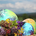 Colored Easter Eggs In Basket And Spring Flowers by Didart Collection