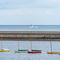 Colorful Boats Lined Up By The Marblehead Harbor Causeway Marblehead Ma by Toby McGuire