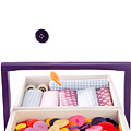 Colorful Buttons Fall Into A Sewing Box by Wolfgang Steiner
