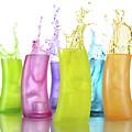 Colorful Drink Splashing From Glasses by Oleksiy Maksymenko
