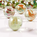 Colorful Glass Marbles Close-up Views by Daniel Ghioldi
