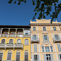 Colourful Facade Of Traditional Buildings In Como, Italy by Alexandre Rotenberg