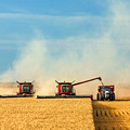 Combines And Tractor Working Together by Todd Klassy