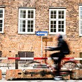 Commuter Going To Work By Cycle In Copenhagen by Leonardo Patrizi