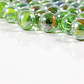 Composition With Green Marbles On White Background by Daniel Ghioldi