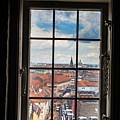 Copenhagen Cityscape And Roofs Behind A Window by Leonardo Patrizi