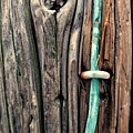Copper Ground Wire And Knothole On Utility Pole by Chester Wiker