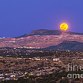 Copper Moon Rising Over The Santa Rita by Alan Dyer