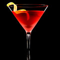 Cosmopolitan Cocktail In Front Of A Black Background  by U Schade