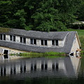 Cottage Sinking In The Rideau Canal by Qingrui Zhang