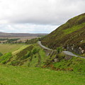Countryside Road Bends Around Hill by Four Stock