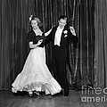 Couple Ballroom Dancing On Stage by H. Armstrong Roberts/ClassicStock