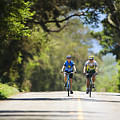 Couple Enjoying A Back Road Bike Ride by Ron Dahlquist - Printscapes