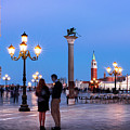 Couple On The Piazzetta San Marco At Night - Venice by Barry O Carroll