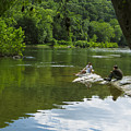 Couple Relaxing By The Shenandoah River At Harpers Ferry by Steve Samples