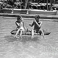 Couple Relaxing In Pool, C.1930-40s by H Armstrong Roberts and ClassicStock