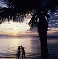 Couple Silhouetted On Beach by Larry Dale Gordon - Printscapes