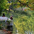Couple Sit Quietly On Jetty And Fish At A Lake Outside Beijing China by Imran Ahmed