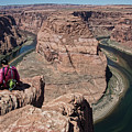 Couple Viewing Horseshoe Bend High Up Edge  by Chuck Kuhn