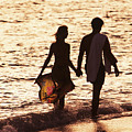 Couple Wading In Ocean by Larry Dale Gordon - Printscapes