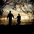 Couple Walking At Sunset by Clayton Bastiani