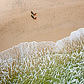 Couple Walking On Tallow Beach by Rob Huntley