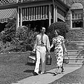 Couple Walking Out Of House, C.1930s by H. Armstrong Roberts/ClassicStock
