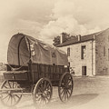 Covered Wagon And Stone Building Sepia by James Barber