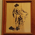 Cowboy And Saddle by Russell Ellingsworth