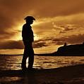Cowboy Silhouette At Wilson Lake In Kansas by Greg Rud
