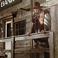 Cowboy Waiting Outside Of A Bank Building by Oleksiy Maksymenko