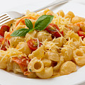 Cream And Tomato Pasta With Fork by Paul Cowan