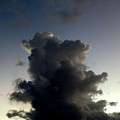 Crescent Moon Over A Storm Cloud by Todd Gipstein