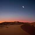 Crescent Moon Over Dunes by Photo by John Quintero
