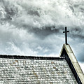 Cross Against An Angry Sky by Bill Dussault