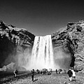 Crowds Of Tourists At Skogafoss Waterfall In Iceland by Joe Fox