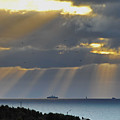 Cruise Ship Passing An Island As Sunrays Shine Through Clouds by Ulrich Kunst And Bettina Scheidulin