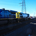 Csx Engines Going Bye Bound Brook Train Stations by William Rogers