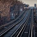 Cta Train Approaching Damen Avenue Station Chicago Illinois by Jim Pearson