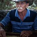 Cuban Domino Player, Manaca Iznaga, Cuba by Dan Hartford