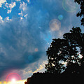 Cumulonimbus Clouds At Sunset by A Gurmankin
