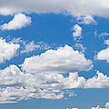 Cumulus Clouds In The Blue Sky by Panoramic Images