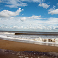Cumulus Clouds Passing Across The Beach At Skegness Lincolnshire England by Michael Walters