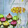 Cupcakes And Gaufrettes Beside A Candle by Henry Stahlhut