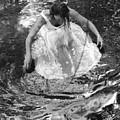 Dancer In White Dress In Shallow Water by Julian West