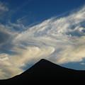 Dancing Clouds Above Volcanic Peak by Andrea Freeman