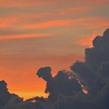 Dark Clouds At Sunset  by Lyle Crump
