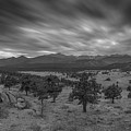 Dark Clouds Passing In Rocky Mountains Np Black And White by Michael Ver Sprill