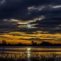 Dark Lake Sunrise by Michael Putthoff
