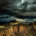 Dark Storm Clouds Over Cliffs by David Stevens